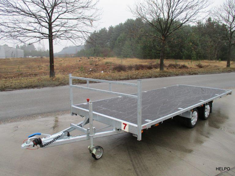 Verhuur nr 7, platte aanhangwagen, geremd, dubbelas, htg 2700kg, 5500mm x 2100mm, optie te huur met oprijplaten. Dagprijs € 50,00